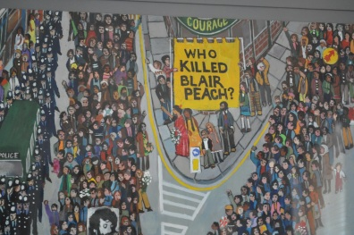 A painting depicting the funeral march of Blair Peach, who was killed in an anti-fascist demonstration in Southall (detail).