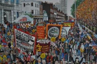 A painting showing an anti-racist march through Cable Street.